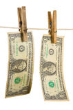 Dollars on clothespin Stock Image