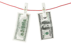 Dollars with clothespins Stock Image