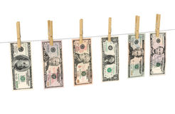 Dollars on clothespins Stock Image