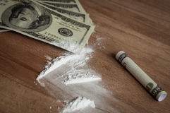 Dollars and cocaine Royalty Free Stock Photos