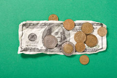 Dollars and coins Stock Photo