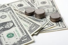 Dollars and coins Stock Photography