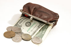 Dollars and coins in pouch Royalty Free Stock Photography