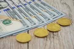 Dollars and coins close-up. Dollars and coins on the table, close-up stock photography