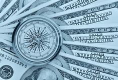 Dollars and compass Stock Photography