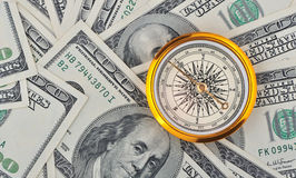 Dollars and compass Royalty Free Stock Photo