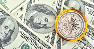 Dollars and compass Stock Image