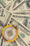 Dollars and compass. Concept about a direction in business royalty free stock images