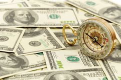 Dollars and compass. Royalty Free Stock Images