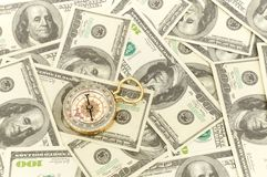 Dollars and compass. Stock Images