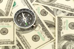 Dollars and compass. Royalty Free Stock Photo