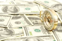 Dollars and compass. Stock Photos