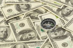 Dollars and compass. Royalty Free Stock Photography