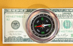 Dollars. The compass is in American dollars Stock Image