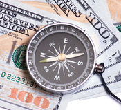 Dollars and compass closeup Stock Photos