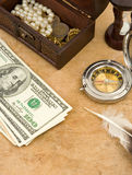 Dollars, compass and hourglass Royalty Free Stock Photography