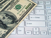 Dollars and computer Royalty Free Stock Image