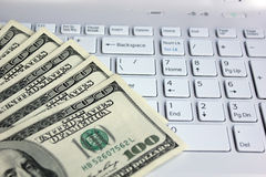 Dollars and computer Royalty Free Stock Images