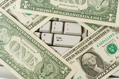 Dollars on the computer keyboard. (showing the 'Enter' button Royalty Free Stock Photos