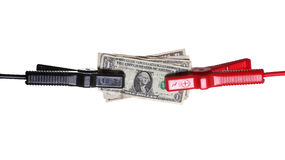 Dollars connected to starter cables Royalty Free Stock Photos