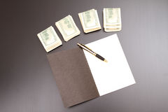 Dollars with a copybook Stock Images