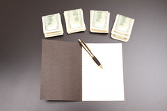 Dollars with a copybook Royalty Free Stock Photos