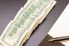 Dollars with a copybook Royalty Free Stock Photo
