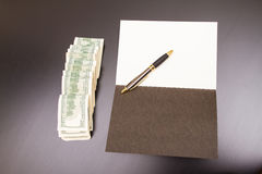 Dollars with a copybook Royalty Free Stock Photography