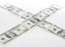 Dollars cross road Stock Images