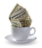 Dollars in a cup. Dollars in white coffee cup Stock Photography