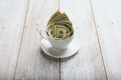 Dollars in cup Stock Photography