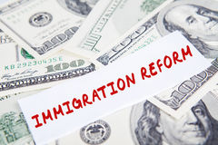 Dollars currency with Immigration Reform word. Image of Immigration Reform word on the paper with dollars currency stock images