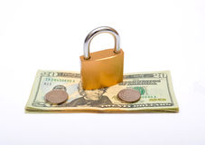Dollars currency with lock on top and coins Stock Images