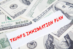 Dollars currency with Trump`s Immigration Plan word. Image of dollars currency with text of Trump`s Immigration Plan, symbolizing Trump Effect in American royalty free stock photos