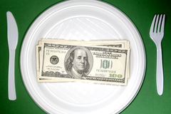 Dollars on cutlery Royalty Free Stock Images