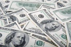 Dollars d'États-Unis d'argent, loupe et blocage d'isolement sur le fond blanc S billet d'un dollar 100 Image stock