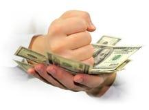 Dollars d'argent dans les mains d'isolement Photos stock