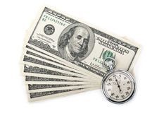 Dollars d'argent et chronomètre Photographie stock