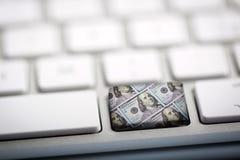 Dollars d'argent sur le clavier Image libre de droits
