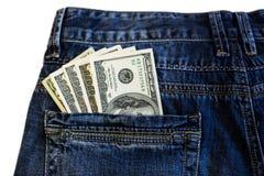Dollars dans des jeans Photos stock