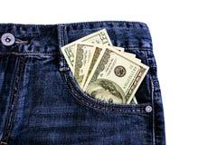Dollars dans des jeans Photographie stock libre de droits