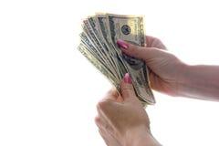 Dollars dans des mains photographie stock libre de droits