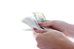 Dollars dans des mains Image libre de droits