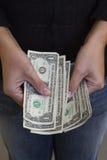 Dollars dans des mains Images stock