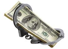 Dollars dans des menottes Photographie stock