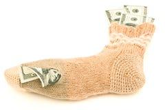 Dollars dans la chaussette photos stock
