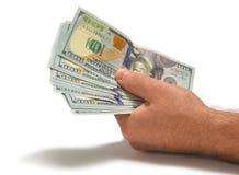 Dollars dans la main des hommes Photographie stock