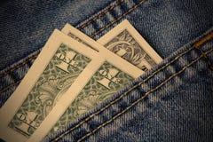 Dollars dans la poche Photo libre de droits