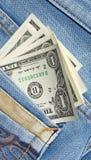 Dollars dans la poche de jeans Photographie stock