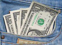 Dollars dans la poche de jeans Photos libres de droits
